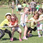 6 little kids playing tug of war